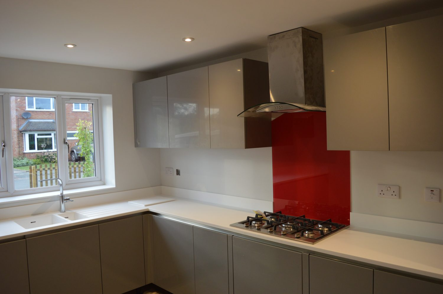 Bespoke Kitchen from George Staffordshire with Red Splashback