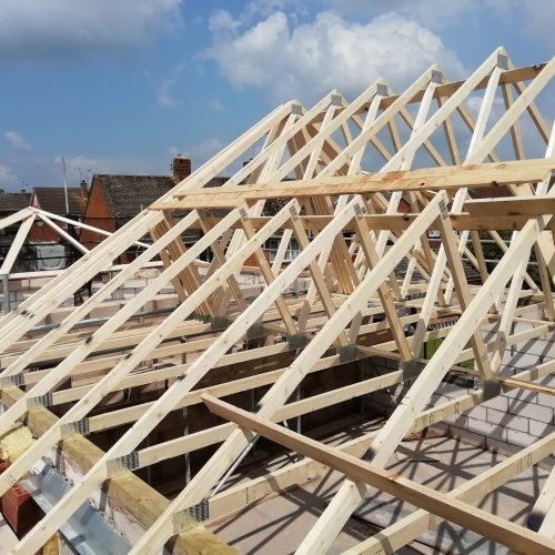 Roof trusses being installed on a sunny day