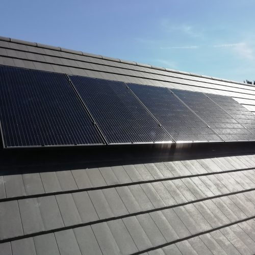 solar panels on a concrete tiled roof