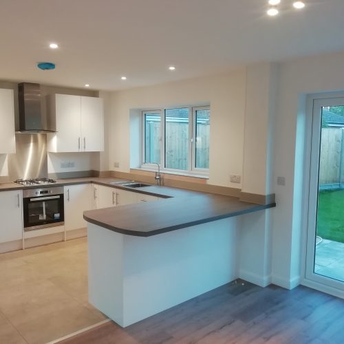 Kitchen With An L Shaped Unit and breakfast bar made by George Staffordshire Developments Ltd