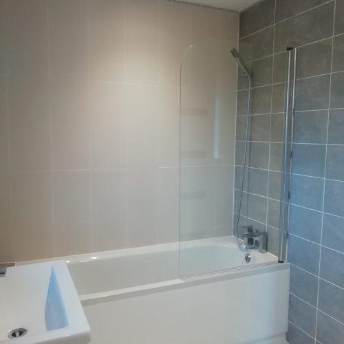 modern tiled bathroom suite mixer shower and bath