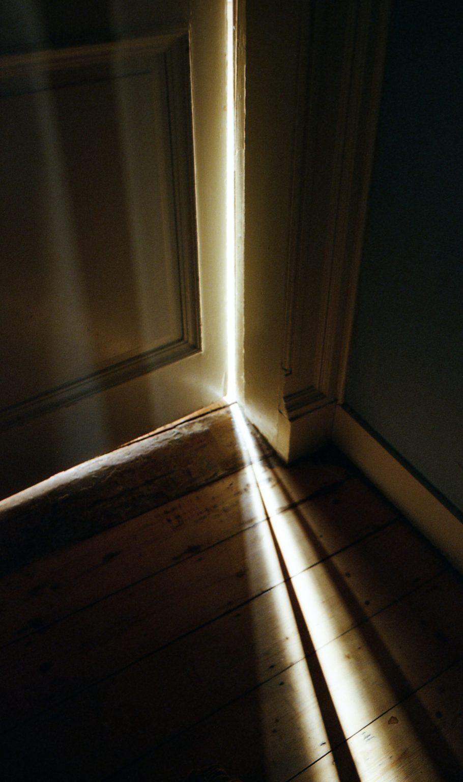 Door Cracked Open with Light Coming Through